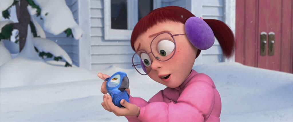 A menina após salvar a arara-azul.